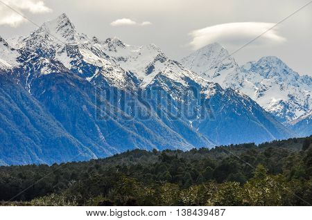Snowy Peaks On The Milford Road, New Zealand
