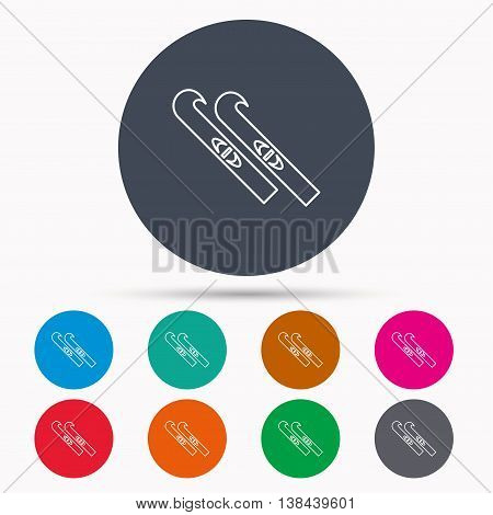 Skiing icon. Skis sign. Winter sport symbol. Icons in colour circle buttons. Vector