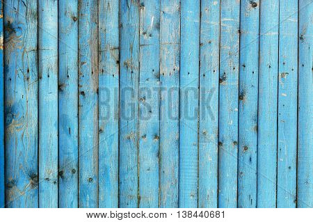 Shabby blue wooden background of old fence
