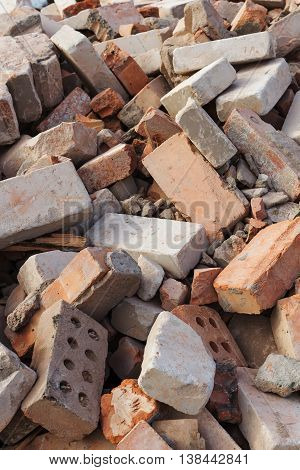 pile of broken bricks after the demolition of the old house