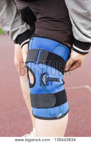 Man keeps for knee in protective gear