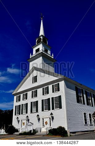 Rindge New Hampshire - July 12 2013: White wooden colonial 1796 Second Rindge Meeting House and Town Hall overlooking the Village Green
