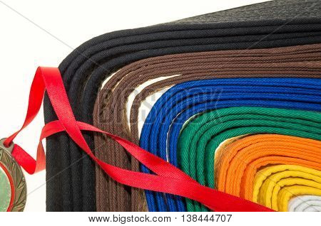 colored belts in martial arts and a part of judo uniform and medal