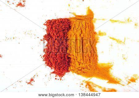 Turmeric (Curcuma) and paprika powders isolated on white background.