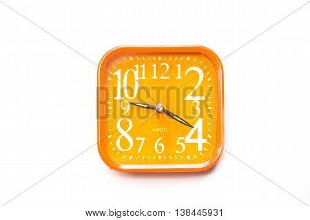 Orange alarm clock isolated on white backgroundClose up orange alerm clock clipping path