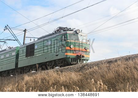St. Petersburg, Russia - 7 April, Railway locomotive on the mound, 7 April, 2016. Transport on rail locomotives and wagons with tanks.