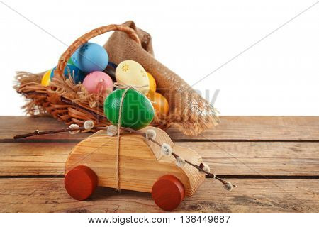 Decorative toy car with pussy willow and Easter egg, isolated on white