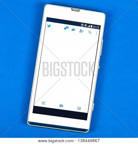 BUNG KAN THAILAND - FEBRUARY 19 2016: smart phone display twitter app on blue background