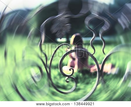 Horizontal pale dream reading woman in park swirl absctraction
