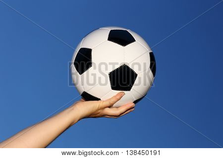 taking ball up success symbol with blue sky