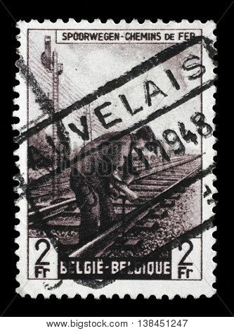 ZAGREB, CROATIA - JULY 03 : stamp printed in Belgium shows Railway Worker from The Railway Company at Work II issue, circa 1945, on July 03, 2014, Zagreb, Croatia