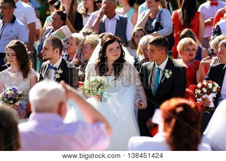 Orel Russia - July 08 2016: Russian Valentine Day - Petr and Fevronia. Two couples of newly wed in crowd selective focus