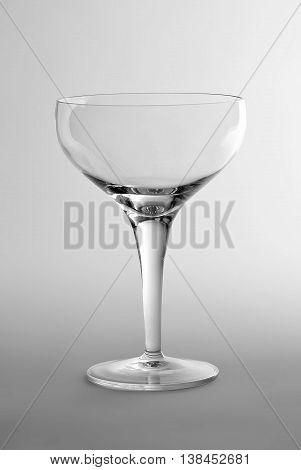 Empty Glass cup champagne on white plane