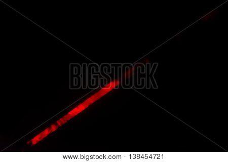 Bright Red Laser Light Shining Visibly Through Fog in Blackness
