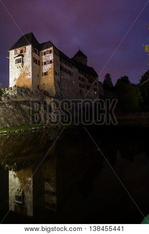 Night-Time Portrait of Castle Matzen Reflected on Water