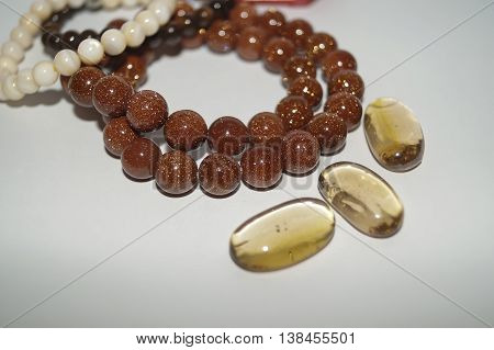 Beads of aventurine and mother of pearl bracelets surrounded by transparent glass yellow stones