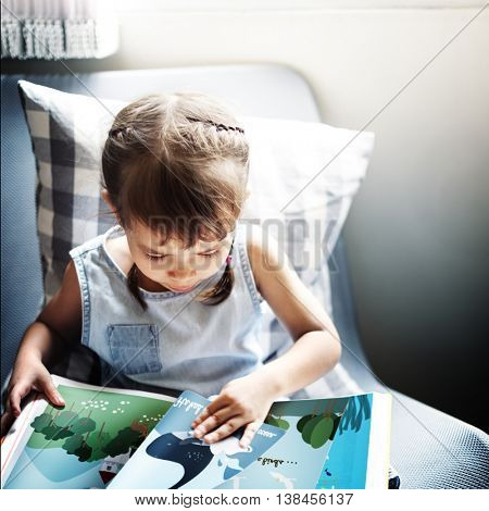 Girl Kid Child Reading Book Concept