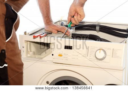electrical worker is screwing with tool on white background