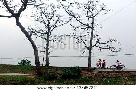 HA NOI, VIET NAM, April 10, 2016 students, suburban Ha Noi. Cycling, on the way home