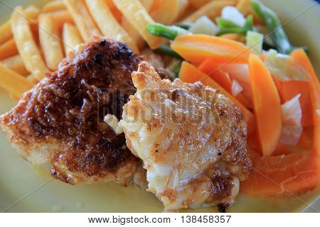 Delicious meal of fresh white fish, French fries and vegetable side dish.