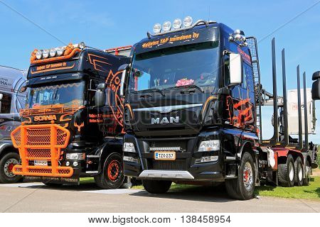 PORVOO, FINLAND - JULY 2, 2016: MAN TGX 39.560 D38 and new Scania Logging trucks of Kuljetus T&P Immonen Oy on Riverside Truck Meeting 2016.