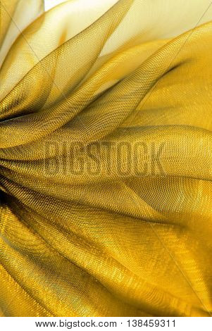 close up of the wavy gold organza fabric