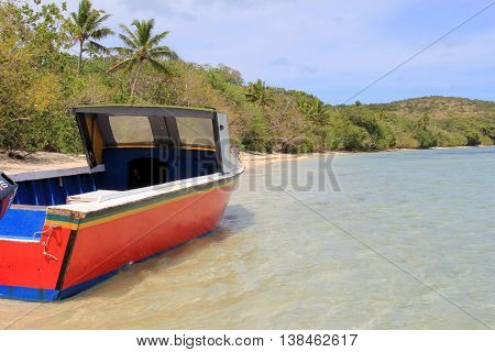 Old,weathered fishing boat in warm waters of South Pacific