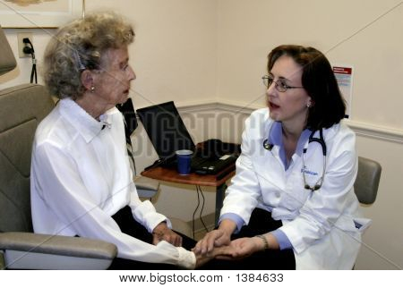Geriatrician And Elderly Woman