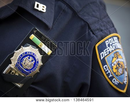 NEW YORK-JULY 12 2016: Close up of a detectives badge with a black mourning band worn by a member of the NYPD out of respect for fallen officers - New York City on July 12 2016.