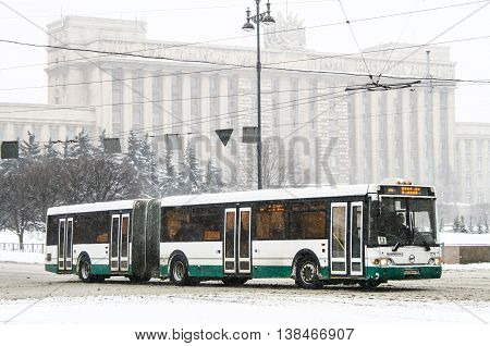 SAINT PETERSBURG RUSSIA - FEBRUARY 9 2011: Articulated city bus LiAZ 6213 in the city street.