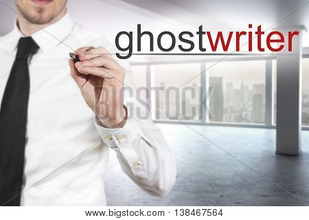 businessman in modern office writing ghostwriter in the air