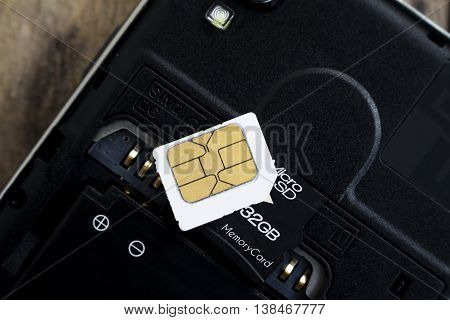 sim card and micro sd card on smart phone soft focused