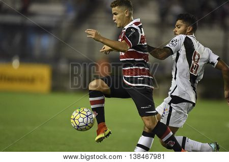 Rio de Janeiro Brasil - july 13 2016: Leandrinho and Henrique player in match between Vasco and Santa Cruz by the Brasil championship in the Sao Januario Stadium