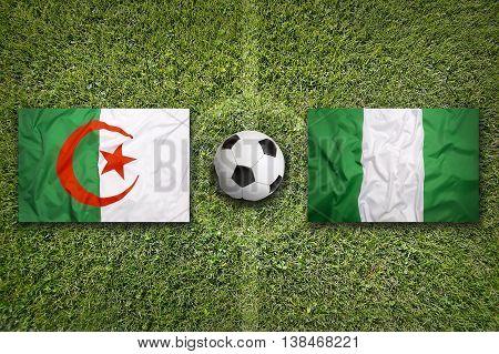 Algeria Vs. Nigeria Flags On Soccer Field