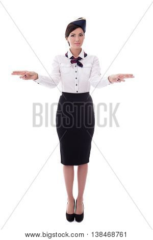 Young Stewardess Indicating Exits Isolated On White