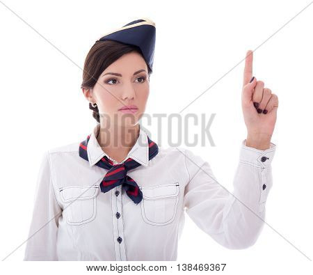 Young Stewardess In Uniform Pointing At Something Isolated On White