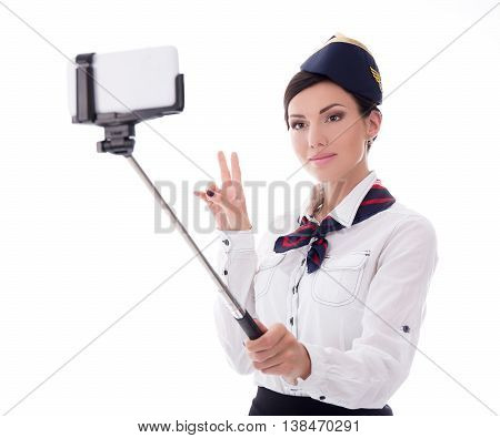 Young Stewardess Taking Selfie Photo With Smart Phone Isolated On White
