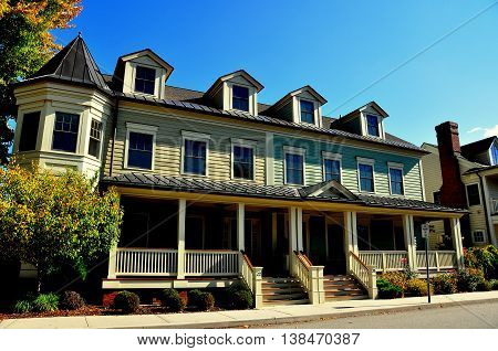 Cold Spring NY - October 17 2014: 19th century wooden Victorian row houses homes with covered porches on West Street in the Lower Village *