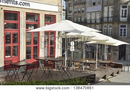 PORTO, PORTUGAL - AUGUST 10, 2016: Nobody in an outdoor restaurant in the historical center of Porto Portugal.