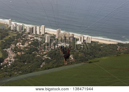 Para-glider preparing to take off from Pedra Bonita ramp in Tijuca Forest National Park, Rio de Janeiro, Brazil
