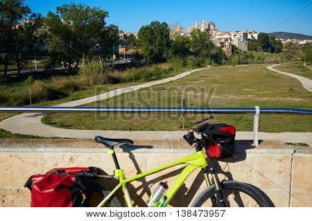 Ribarroja del Turia village from old stone bridge with bicycle at valencia spain
