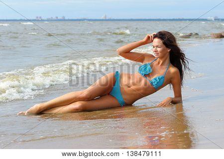 Woman in blue bikini at the sea