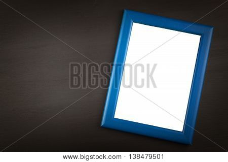 Frame for photos on a wooden background. Wish on a postcard.