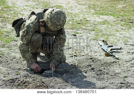 Military soldiers at tactical exercises with mine