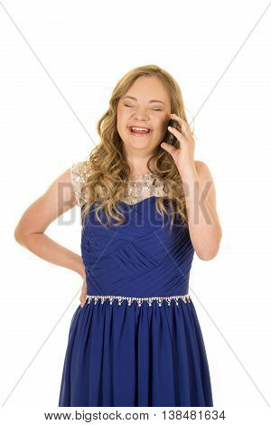 a woman with down syndrome laughing while talking on her phone laughing.