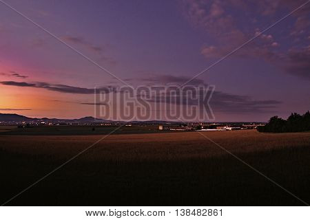 2016/07/04 Keblice Czech republic - evening photo from Ceske stredohori region with villages Keblice Nove Kopisty and cities Litomerice with Bohusovice nad Ohri on background