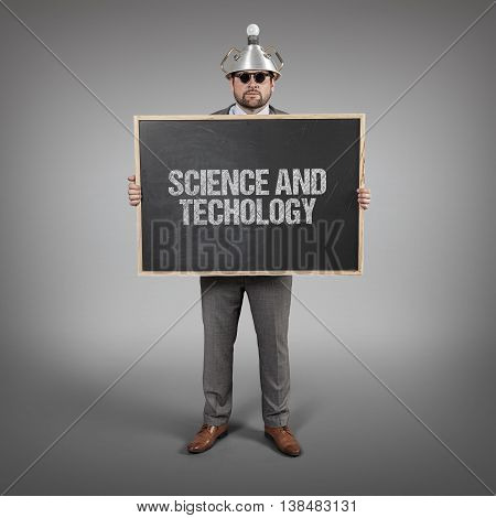science and techology text on blackboard with science businessman holding blackboard sign
