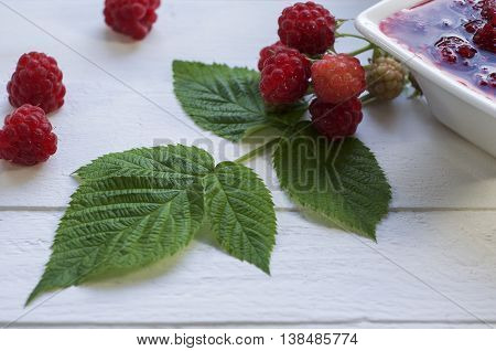 Branch with green leaves of raspberry raspberry and raspberry jam