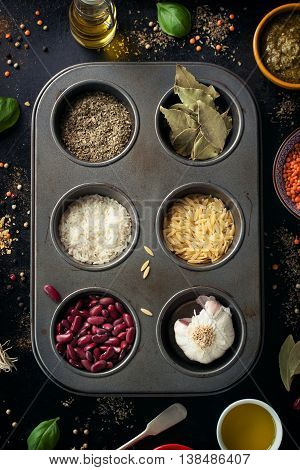Different types of spices and grains on a vintage background healthy concept top view toned