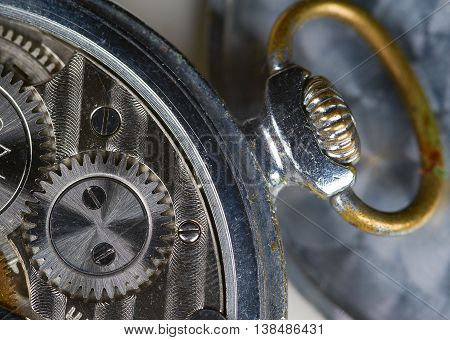 Old mechanical watch mechanism with gears closeup